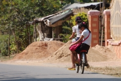 Cycling to school. Unlike England with its one-per-car commuters, every mode of transport in Asia is shared