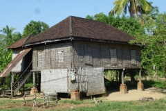 Typical Cambodian house on stilts; creepy crawlies, floodwaters and obnoxious neighbours all left safely below
