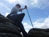 Stewart atop a tor