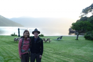 A photo on the lawn of Mahana Lodge at dawn, ready for our second day on the Queen Charlotte Track
