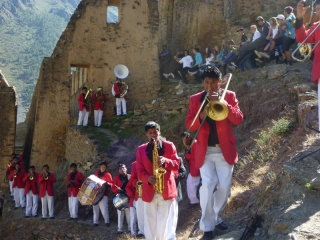 A brass band in bright red jackets - just what you expect to find at 8am on an Inca ruin half-way up a mountain