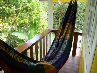 Lost in a hammock, on the balcony of our cosy lodgings in Mindo
