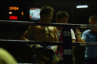 A muay thai fighter prepares for his fight.  I could do this.  Certainly my body looks much the same