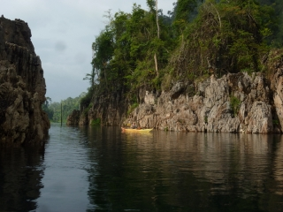 Kayaking through the limestone outcrops of Khao Sok, where once were mountains and valleys is now a lake